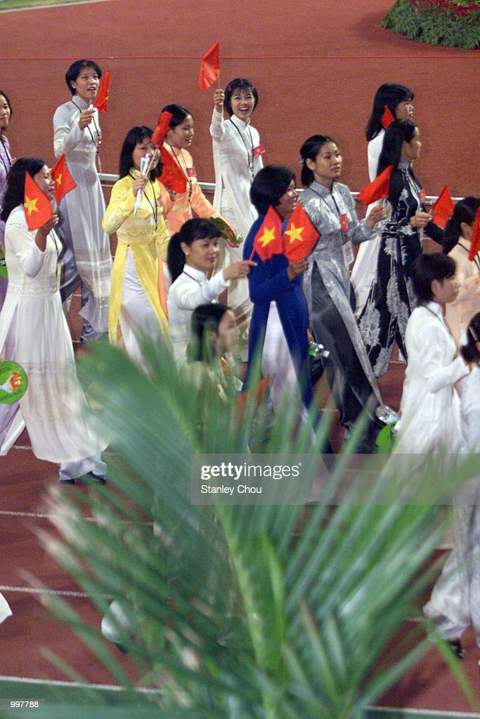 The Vietnamese Female Contigent marching in during the Opening Ceremony held at the Bukit Jalil National Stadium, Kuala Lumpur, Malaysia during the 21st South East Asian Games. DIGITAL IMAGE. Mandatory Credit: Stanley Chou/ALLSPORT
