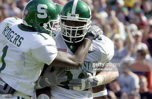 Tight end Chris Baker of Michigan State is congratulated by receiver Charles Rogers after catching a touchdown pass in the second quarter at Notre...