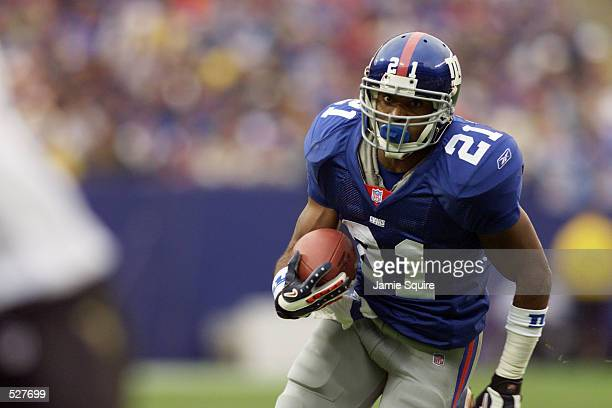 Tiki Barber of the New York Giants runs against the New Orleans Saints during the game at the Meadowlands in East Rutherford New Jersey The New York...