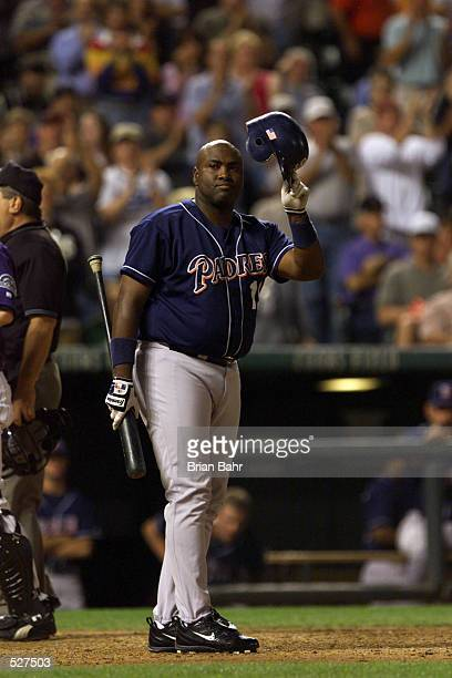 Tony Gwynn of the San Diego Padres acknowledges the crowd after hitting against the Colorado Rockies during the game at Coors Field in Denver...