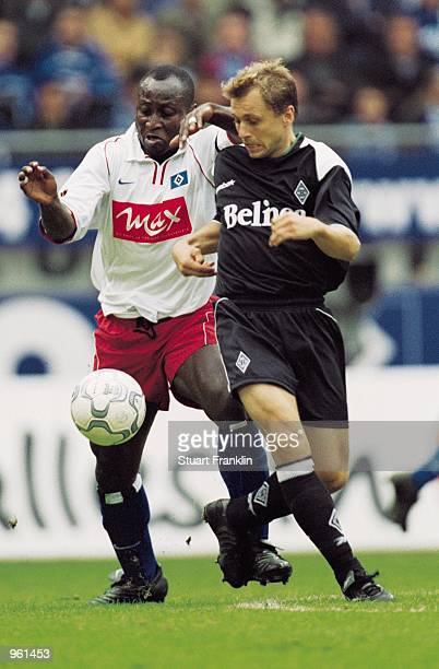 Tony Yeboah of Hamburg SV tussles with Peter Nielsen of Borussia Monchengladbach during the German Bundesliga match played at the Volksparkstadion in...