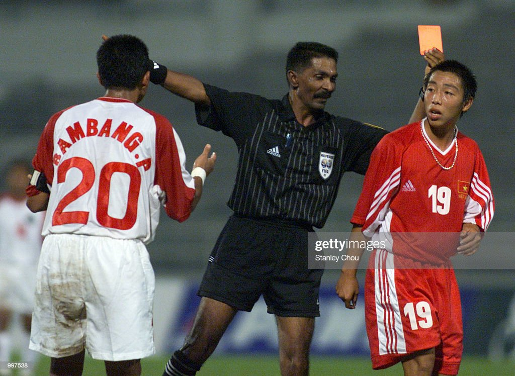 Tran Anh Tuan of Vietnam is shown the red card by the Referee as Bambang Pamungkas of Indonesia looks on in a Group B match held at the MPPJ Stadium, Petaling Jaya, Malaysia during the Under-23 Men Football Tournament of the 21st South East Asian Games. Indonesia won 1-0. DIGITAL IMAGE. Mandatory Credit: Stanley Chou/ALLSPORT
