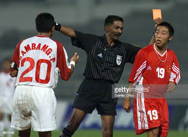 Tran Anh Tuan of Vietnam is shown the red card by the Referee as Bambang Pamungkas of Indonesia looks on in a Group B match held at the MPPJ Stadium...