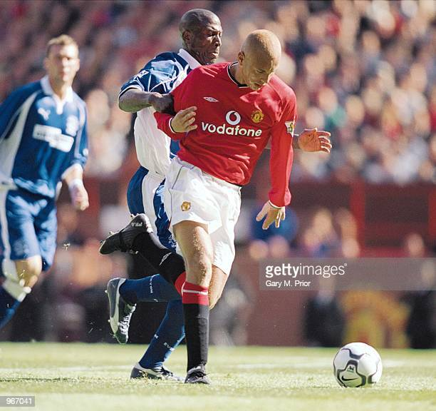 Wes Brown of Manchester United holds off Kevin Campbell of Everton during the FA Barclaycard Premiership match played at Old Trafford in Manchester...