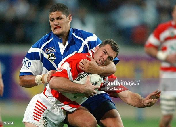 Willie Mason of the Bulldogs tackles Jason Hooper of the Dragons during the NRL qualifying final between the Bulldogs and the St George Illawarra...