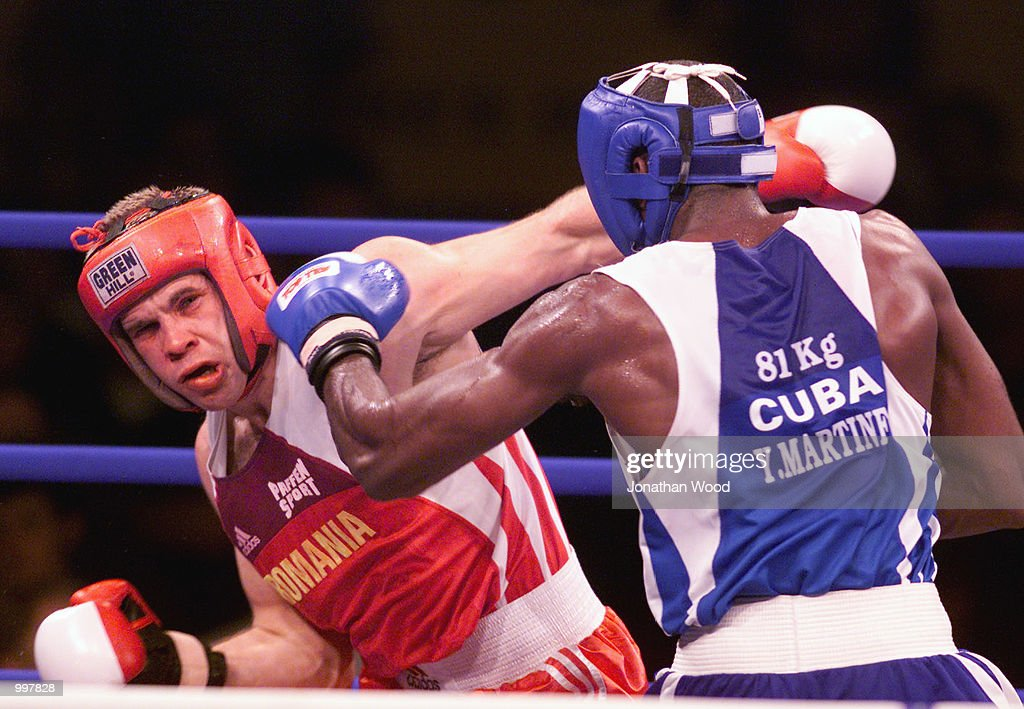 Yohason Martinez of Cuba exchanges blows with opponent Grigore Rasco of Romania during the 81 kg Gold Medal bout held at the South Bank Convention Centre, Brisbane, Australia. DIGITAL IMAGE. Mandatory Credit: Jonathan Wood/ALLSPORT