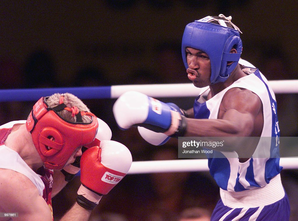 Yohason Martinez of Cuba throws a punch at opponent Grigore Rasco of Romania during the 81 kg Gold Medal bout held at the South Bank Convention Centre, Brisbane, Australia. DIGITAL IMAGE. Mandatory Credit: Jonathan Wood/ALLSPORT