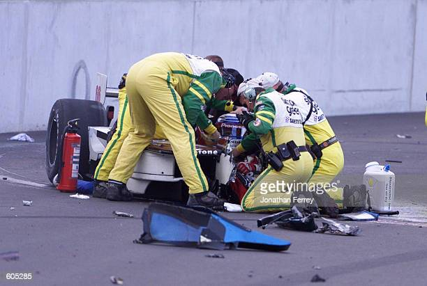 Safety crew members work to assist the seriously injured Italian driver Alex Zanardi following his accident at the American Memorial renamed from the...