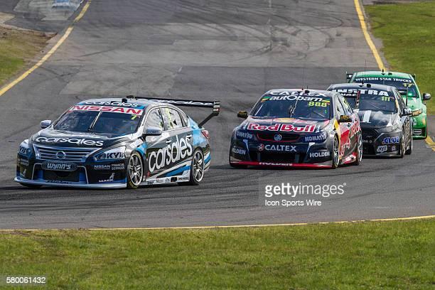 Alex Buncombe of Nissan Motorsport leads Steven Richards of Red Bull Racing Australia Andre Heimgartner of Super Black Racing and Marcos Ambrose of...