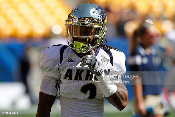 Akron Zips Wide Receiver Tyler Williams laughs at panther fans heckling him during warmups in the game between the Akron Zips and the Pittsburgh...