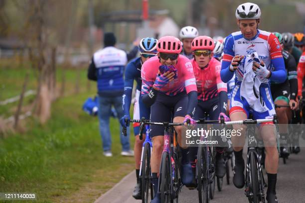 Sep Vanmarcke of Belgium and Team Ef Education First / Matthieu Ladagnous of France and Team Groupama - FDJ / Raincoat / Peloton / during the 78th...
