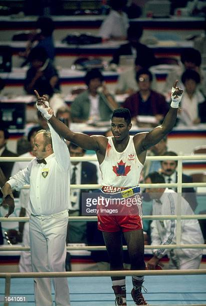 Lennox Lewis of Canada celebrates after winning the gold medal in the Super Heavyweight bout against Riddick Bowe of the USA during the 1988 Olympics...
