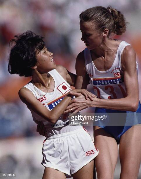 Liz McColgan of Great Britain is congratulated by Akemi Matsuno of Japan after winning the silver medal for the 10000 Metres event at the 1988...