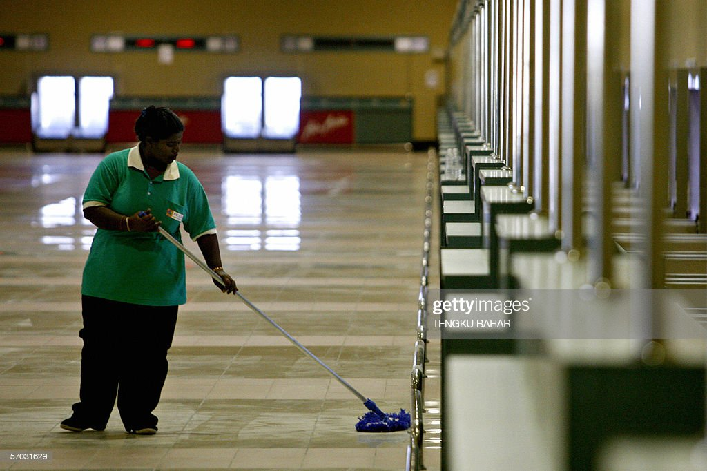 A janitorial services worker cleans the : News Photo