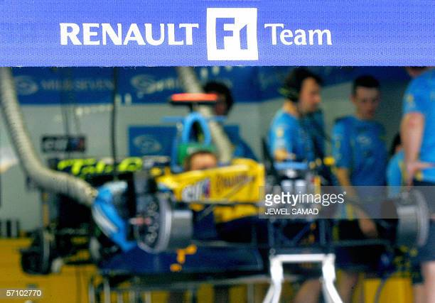 F1 Grand Prix world champion team Renualt crew assemble one of their car inside a pit at the Sepang F1 racetrack in Sepgang 16 March 2006 The...