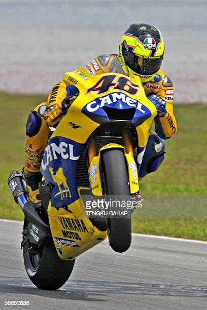 Italian Valentino Rossi pops a wheelie on his 2006 Yamaha M1 bike after completing a test run at the Sepang International Circuit in Sepang 15...