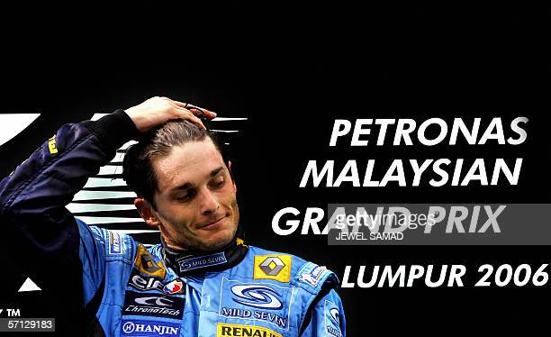 Malaysian Grand Prix winner Italian Formula One driver Giancarlo Fisichella gestures after the race at the Sepang racetrack in Sepang 19 March 2006...