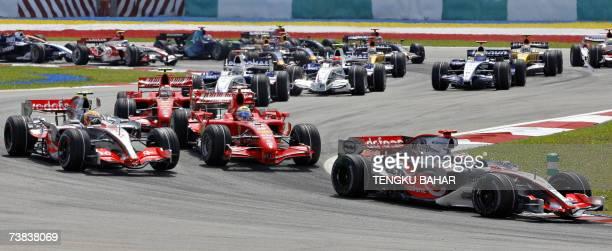 Spanish Formula One Driver Fernando Alonso of McLaren leads the pack followed by Brazilian Felipe Massa of Ferrari British Lewis Hamilton of McLaren...