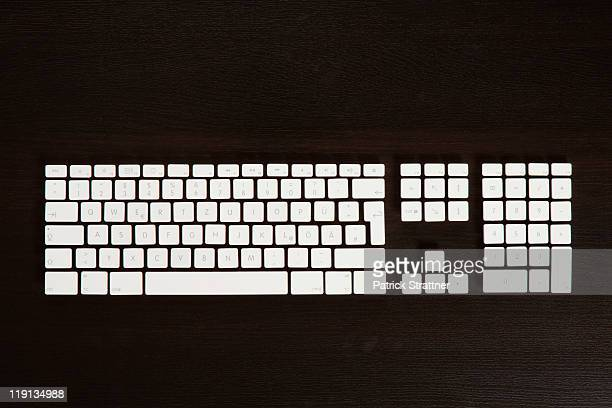 Separate computer keys arranged to look like an actual keyboard