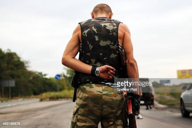 A separatist fighter stands guard on September 10 2014 in Donetsk Ukraine Despite a declared ceasefire between separatists forces and the Ukrainian...