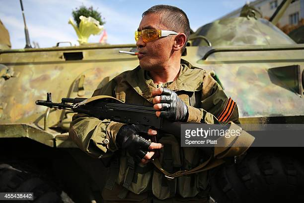 A separatist soldier smokes during a city celebration in Lugansk on September 14 2014 in Lugansk Ukraine Lugansk a separatist held city close to the...