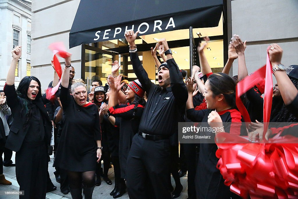 Sephora beauty advisers dance during the ribbon cutting ceremony at Sephora Brooklyn Grand Opening on November 1, 2013 in New York City.
