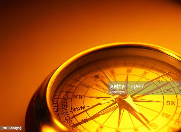sepia toned close-up of a metal compass