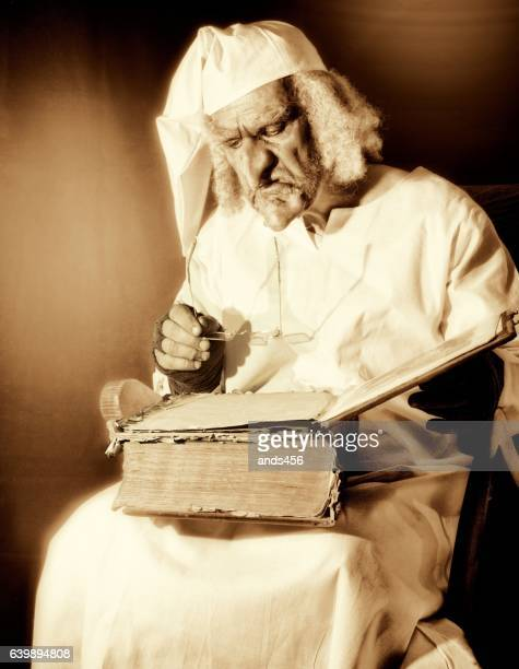 sepia toned image of old fashioned character in nightshirt