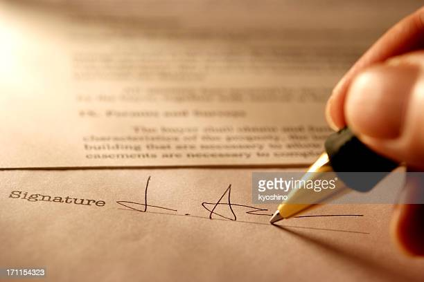 sepia toned image of signing a contract with light rays - permission concept stock pictures, royalty-free photos & images