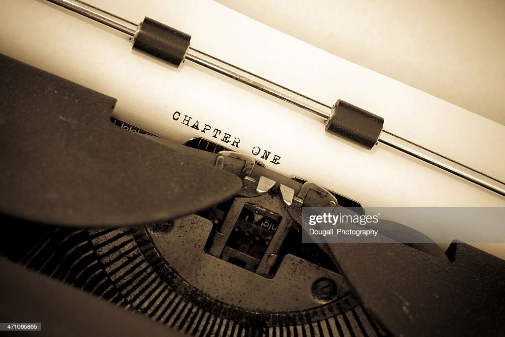Sepia Toned Vintage Typewriter with Chapter One Typed Out : Stock Photo