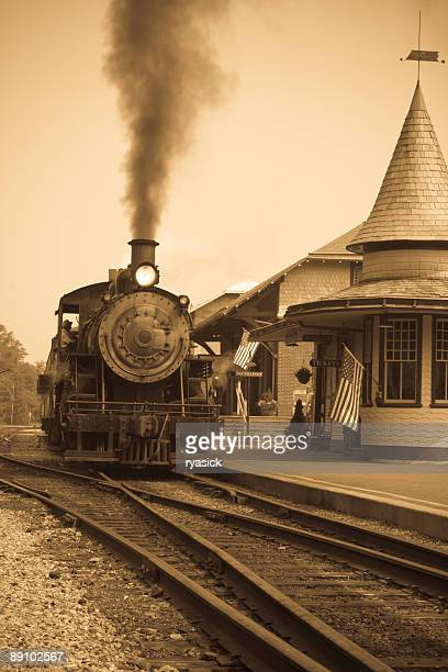 sepia vintage antique steam locomotive at railroad station - cowcatcher stock pictures, royalty-free photos & images
