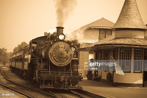 Sepia-toned Antique Steam Locomotive Engine at Train Station Platform