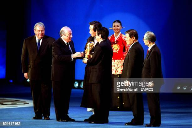 Sepp Blatter FIFA President hands over the World Cup to the President's of the Korean and Japanese FA in preparation for the World Cup 2002