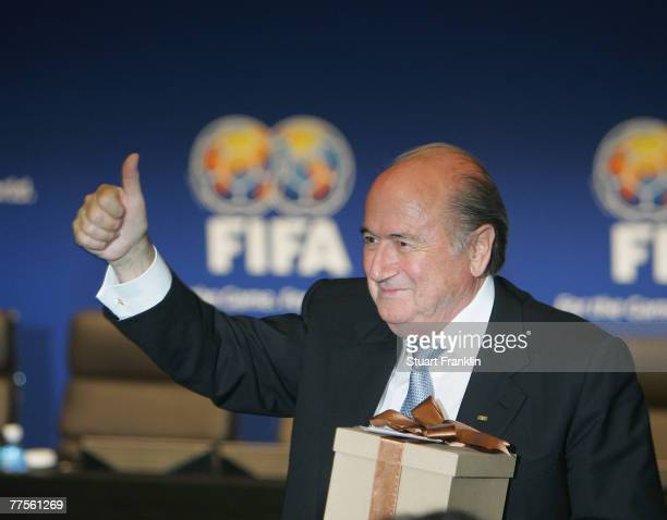Sepp Blatter President of FIFA give the thumbs up after recieving a gift from the Brazilian delegationduring the FIFA Executive Committee...