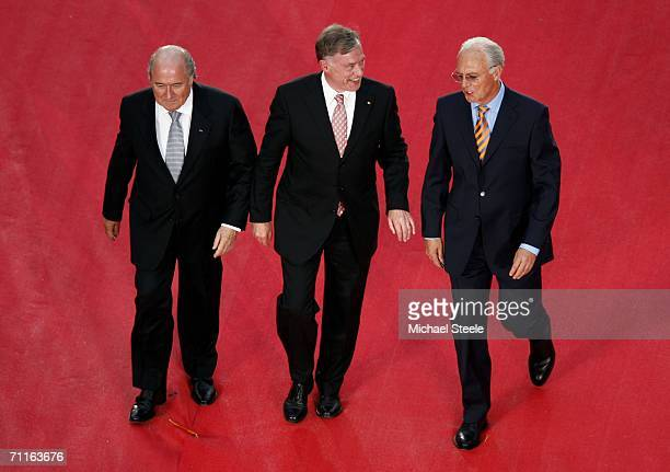 Sepp Blatter the Fifa President Horst Koehler the German President and Franz Beckenbauer the President of the World Cup Organizing Committee enter...