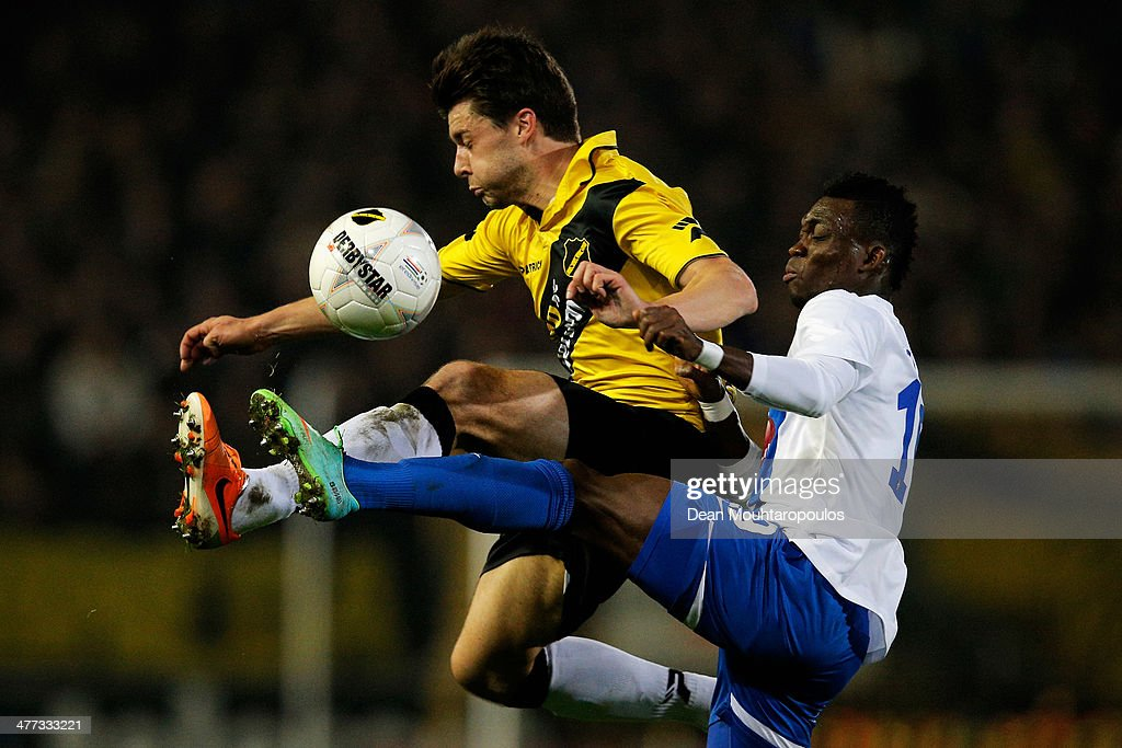 Sepp De Roover (L) of NAC and Christian Atsu of Vitesse battle for the ball during the Eredivisie match between NAC Breda and Vitesse at the Rat Verlegh Stadion on March 8, 2014 in Breda, Netherlands.