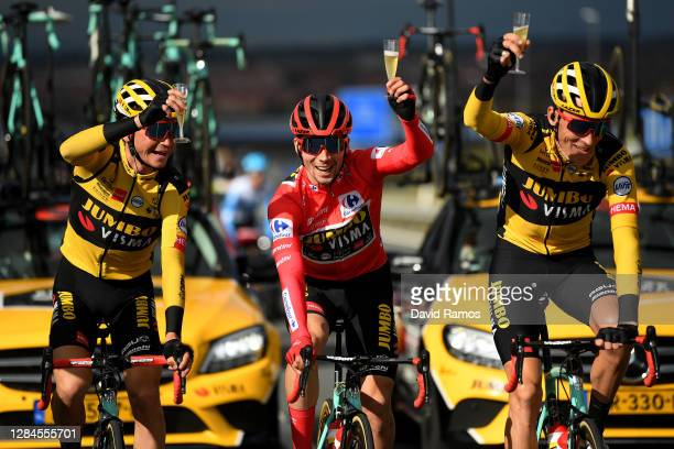 Sepp Kuss of The United States, Primoz Roglic of Slovenia Red Leader Jersey and Robert Gesink of The Netherlands and Team Jumbo - Visma / Champagne /...