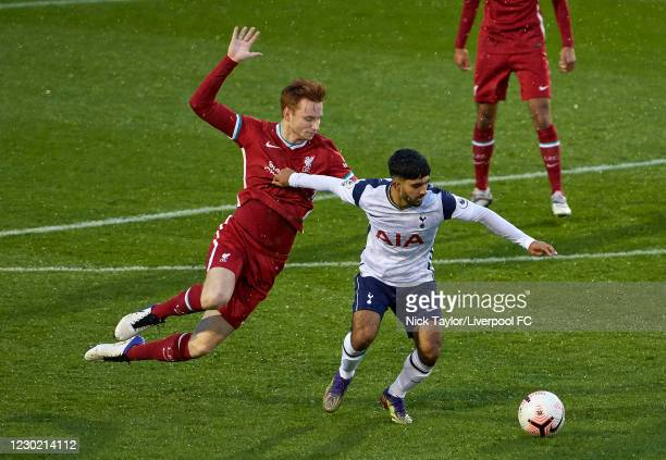 Sepp van den Berg of Liverpool and Dilan Markanday of Tottenham Hotspur in action during the PL2 match at AXA Training Centre on December 19, 2020 in...