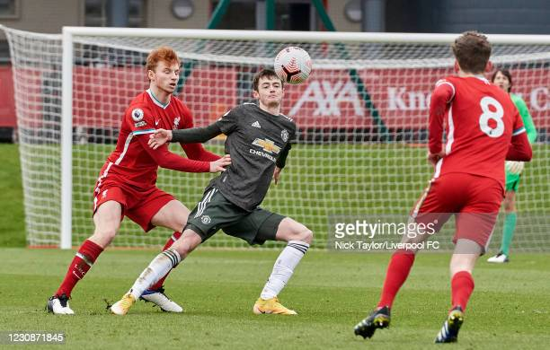 Sepp van den Berg of Liverpool and Joe Hugill of Manchester United in action during the PL2 game at AXA Training Centre on January 30, 2021 in...