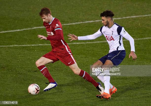 Sepp van den Berg of Liverpool and Kion Etete of Tottenham Hotspur in action during the PL2 match at AXA Training Centre on December 19, 2020 in...