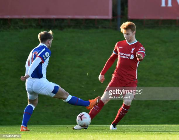 Sepp Van Den Berg of Liverpool U23's competing with Daniel Butterworth of Blackburn Rovers U23 during the Premier League 2 match between Liverpool...