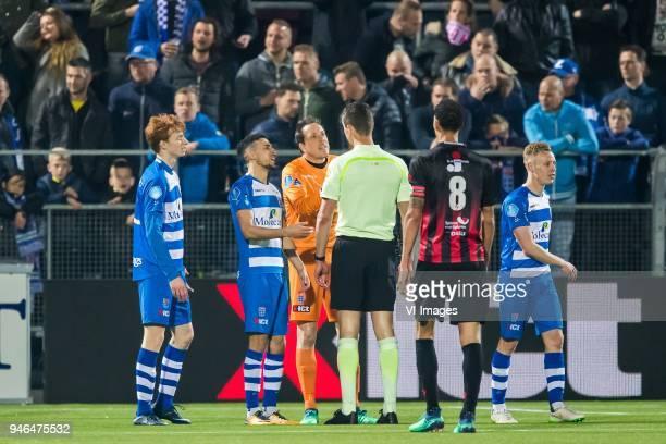 Sepp van den Berg of PEC Zwolle Younes Namli of PEC Zwolle goalkeeper Diederik Boer of PEC Zwolle referee Christiaan Bax Ryan Koolwijk of sbv...