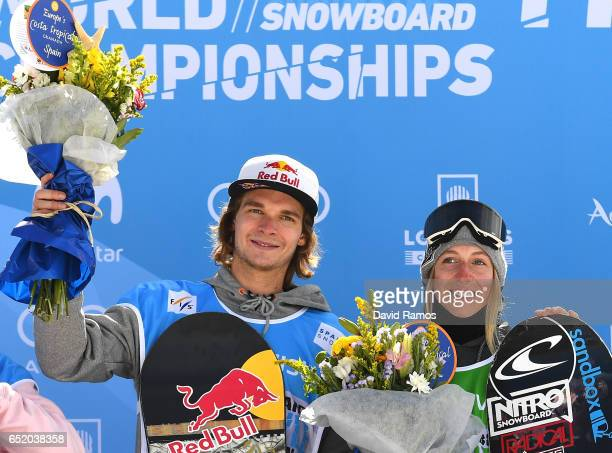 Seppe Smits of Belgium and Laurie Blouin of Canada celerate winning their Gold medals during the medal ceromeny after their Slopestyle Finals on day...