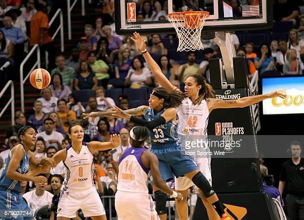 Lynx Guard Seimone Augustus passes the ball outside as Mercury Center Brittney Griner protects the basket The Phoenix Mercury host the Minnesota Lynx...