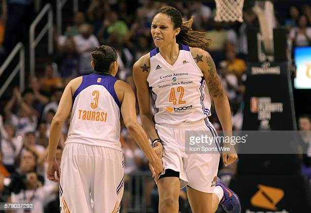 Mercury Center Brittney Griner celebrate with teammate Diana Taurasi The Phoenix Mercury host the Minnesota Lynx in the 3rd game of the Western...
