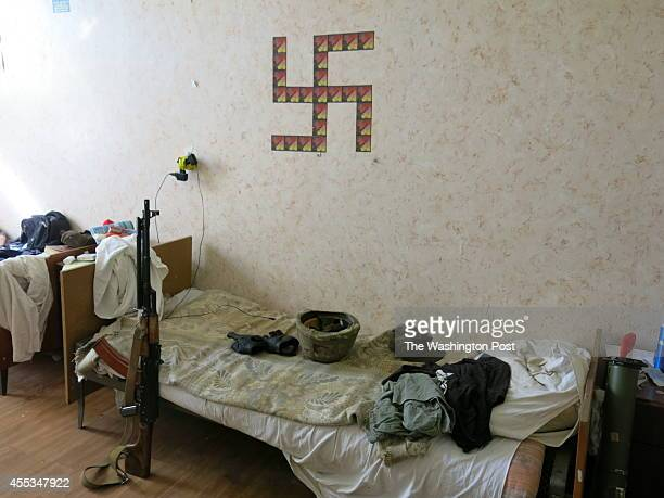 A swastika adorns the wall of the bunkhouse of the Azov BattalionMembers of the volunteer Azov Battalion have been preparing for the defense of the...