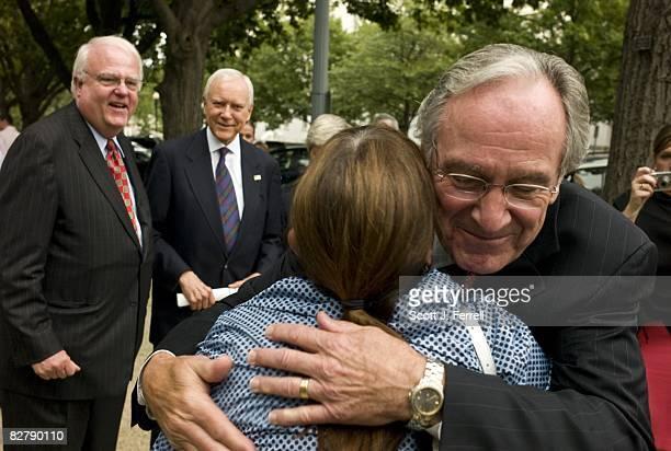 Rep James F Sensenbrenner Jr RWis and Sen Orrin G Hatch RUtah look on as Sen Tom Harkin DIowa hugs Cheryl Sensenbrenner of the American Association...