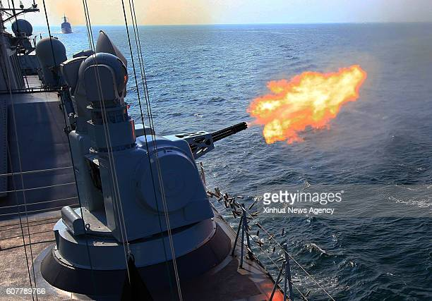 GUANGZHOU Sept 18 2016 Chinese frigate Guangzhou fires secondary guns during a ChinaRussia naval joint drill at sea off south China's Guangdong...