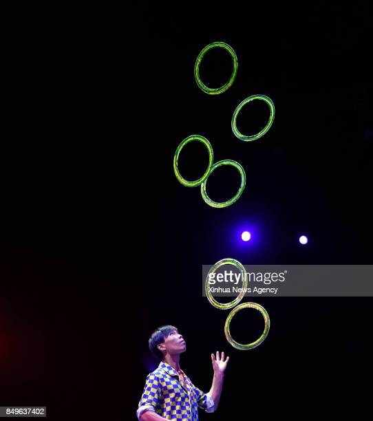 PENGLAI Sept 19 2017 An acrobat performs at the contest for the 10th China Acrobatics Golden Chrysanthemum Award in Penglai east China's Shandong...