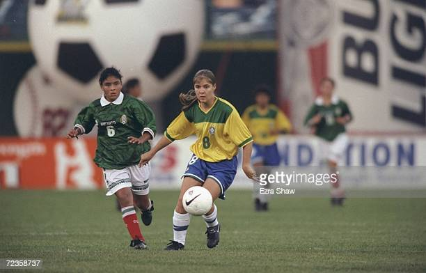 Elane of the Team Brazil kicks the ball during the Womens World Cup soccer game against Team Mexico at the Frontier Field in Rochester New York The...